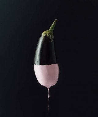Eggplant with dripping pink paint