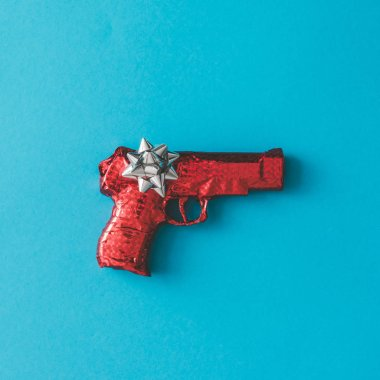 Gun wrapped in red paper with bow