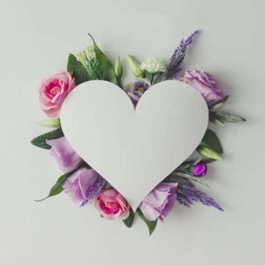 Creative layout with flowers and heart shape