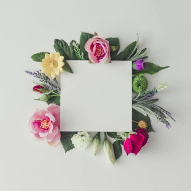 Creative layout with colorful flowers and leaves