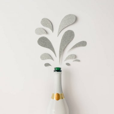 Champagne bottle with silver glittering splashes