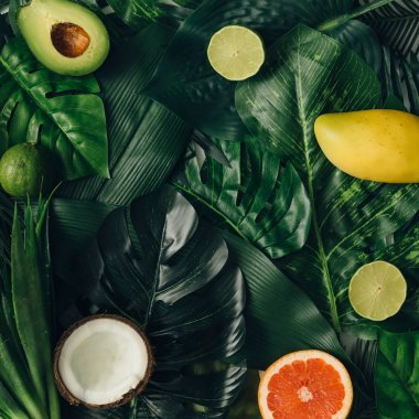 layout made of tropical fruits on leaves