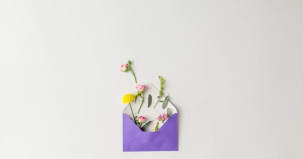 paper card envelope with flowers forming word love, love concept