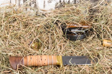 The weapon and knife were hidden in straw