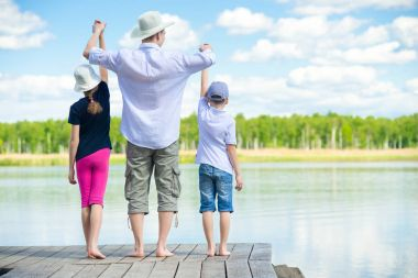 father brought children to the river, camping outdoors