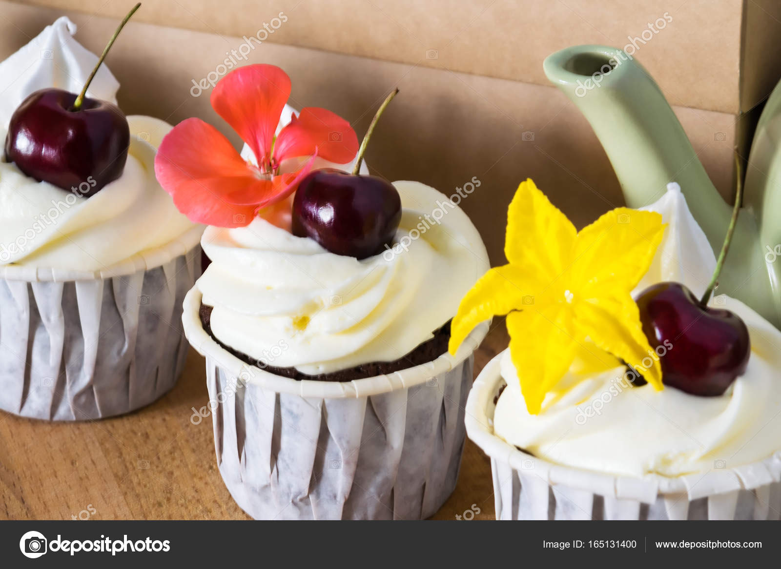Three Beautiful Cakes With Cherries And Flowers On A Teapot