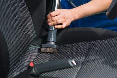 Dry cleaning of car seats by a specialist close-up