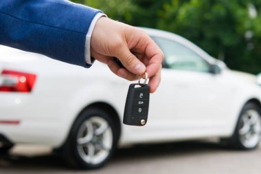 Transfer of a car to a new owner for money, ignition keys in the manager's hand