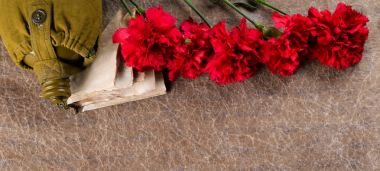 a set of old letters, with carnations and a flask, on a texture background with an inscription