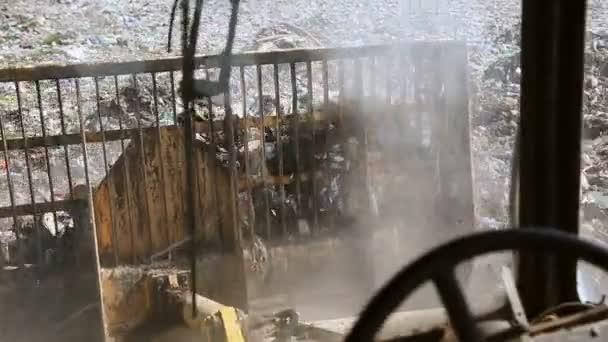 Bulldozer move trash in a landfill. Contamination of the environment. environmental disasters