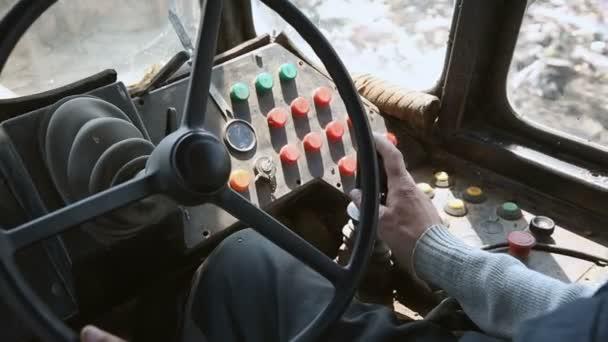 Managing an old bulldozer. Close-up hand of man
