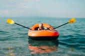 little boy in boat