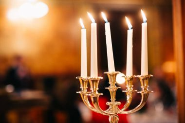 candles in church against blurred background