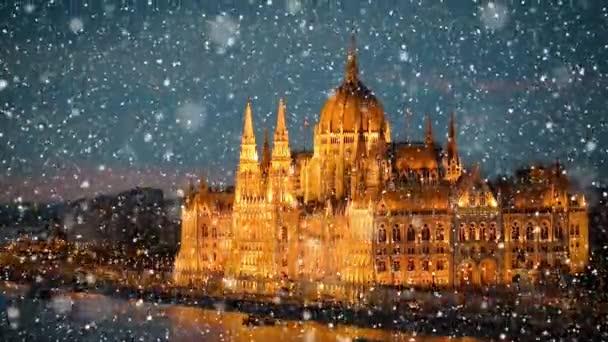 festői felvétel a Parlament napnyugtakor készült épületéről hópelyhekkel az előtérben
