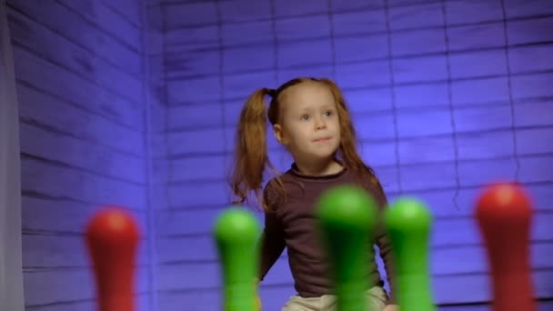 Little girl playing bowling