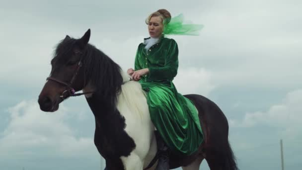 A woman in a green suit is riding a horse 4k