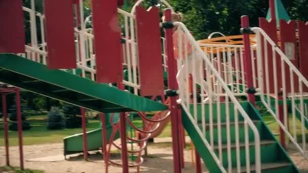 Child Sliding on a Slide in Park, Little Girl Playing at Playground, Children