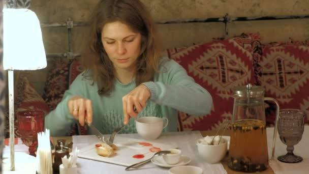 Happy woman eating sweet tasty dessert