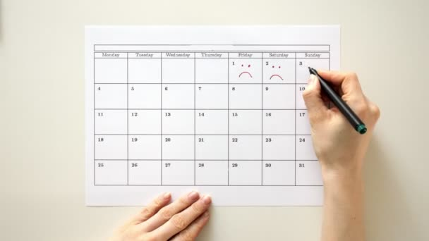 Sign the day in the calendar with a pen, draw a smile