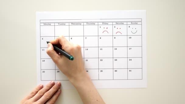 Podepsat den v kalendáři s perem, nakreslit úsměv