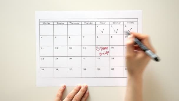 Sign the day in the calendar with a pen, draw a birthday