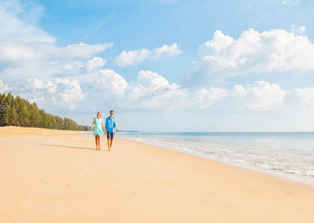 Couple walking on the beautiful beach