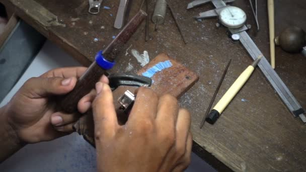 Gold smith making a ring' s wax mold curving , jewelry making,Slow motion