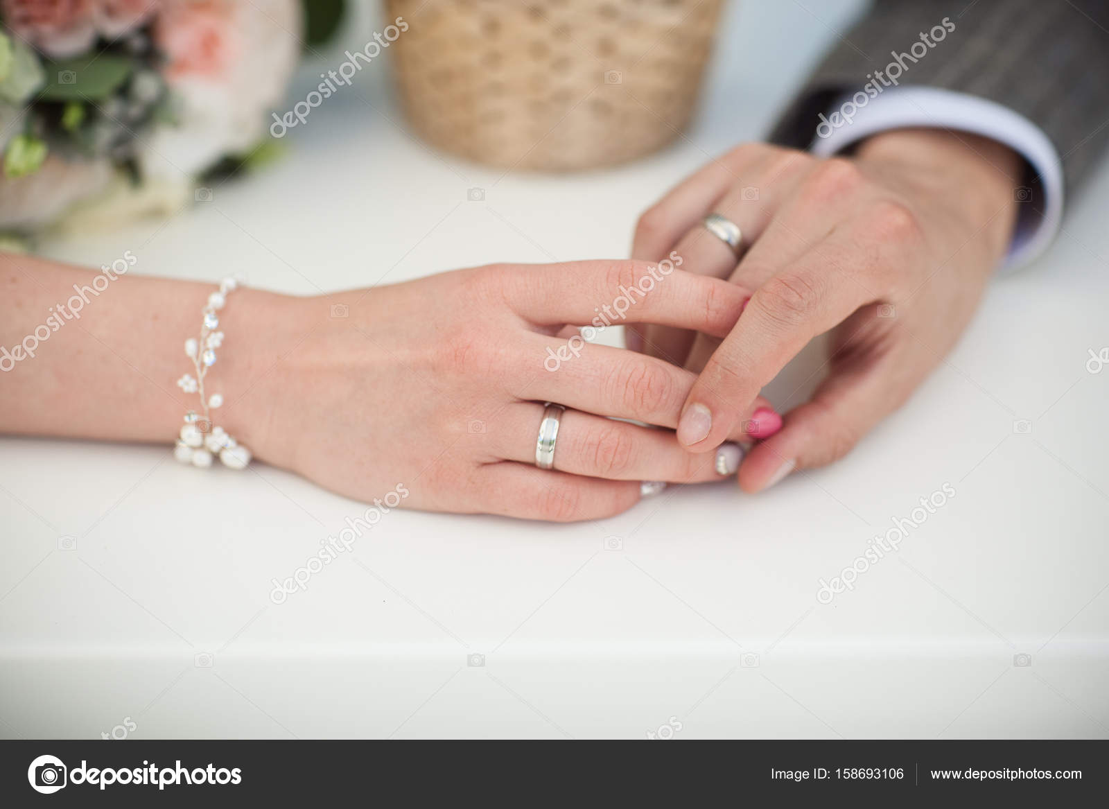 Hands of husband and wife with rings Stock Photo alfotobkru