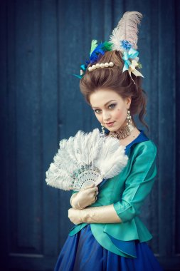 Beautiful caucasian girl dressed in rococo style