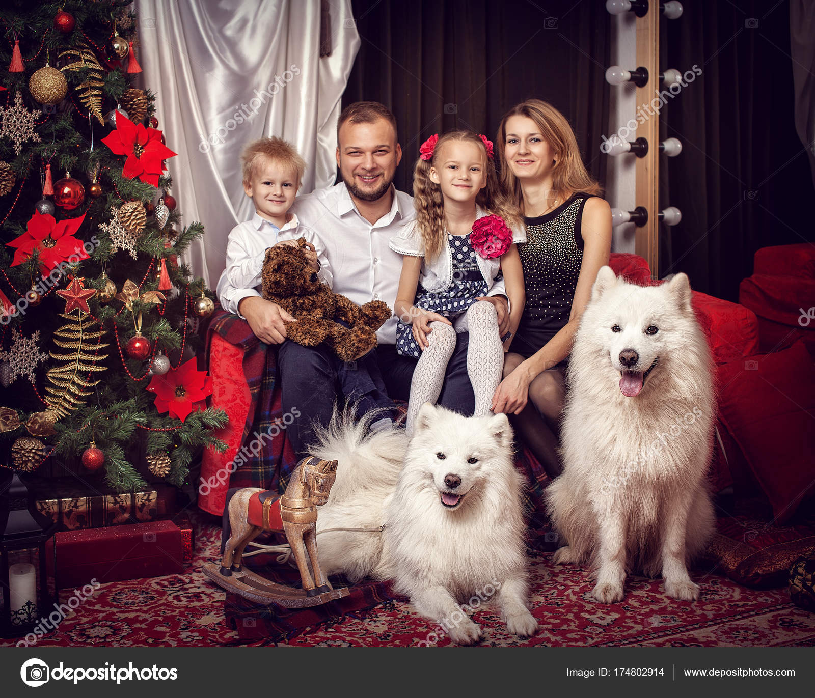 Family with two white dogs near the Christmas tree \u2014 Stock