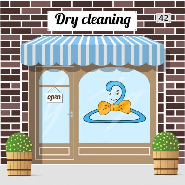 Dry cleaning service. Brown brick facade building. Cartoon sticker on window. Stone front. Vector illustration. clip art vector