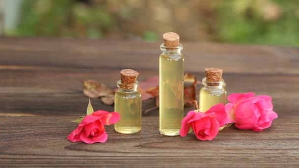 Essence of rose on table in beautiful  bottle