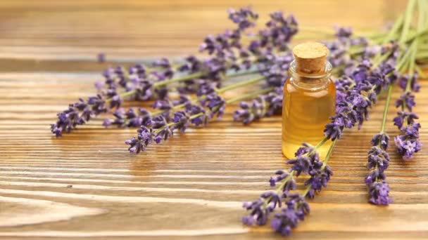 lavender essential oil in  beautiful bottle on table