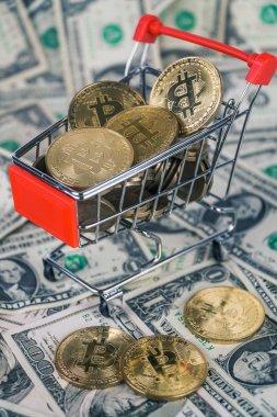 bitcoins in mini market trolley. on dollars