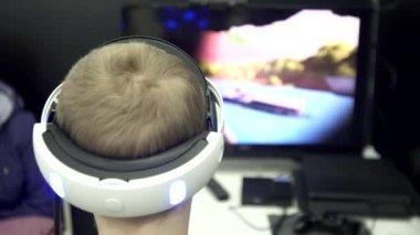 YAROSLAVL,RUSSIA-December 12,2017 : VR games,Teens use virtual reality helmets Sony PlayStation 4,