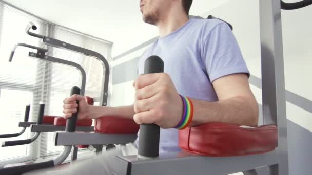a man with a bracelet lgbt engaged in the gym