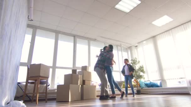 family moves into a new apartment