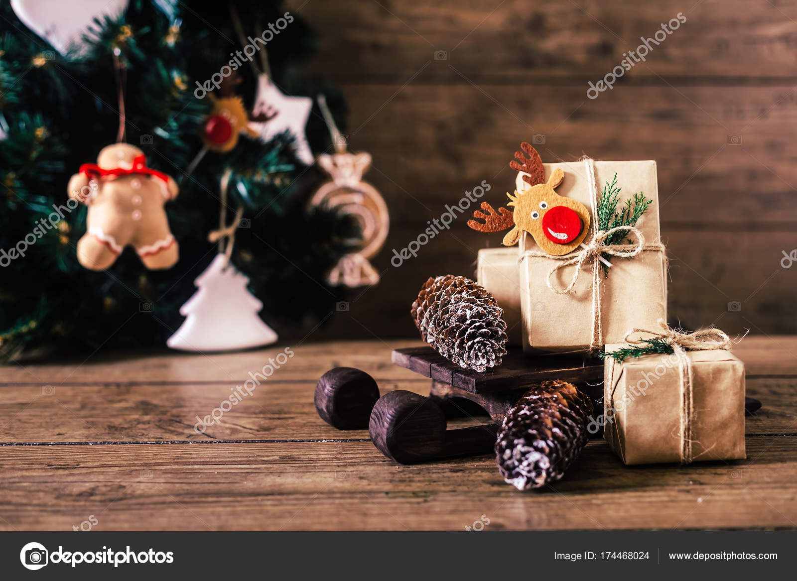 christmas gifts with boxes on wooden background vintage style closeup selective focus - Vintage Sled Christmas Decoration