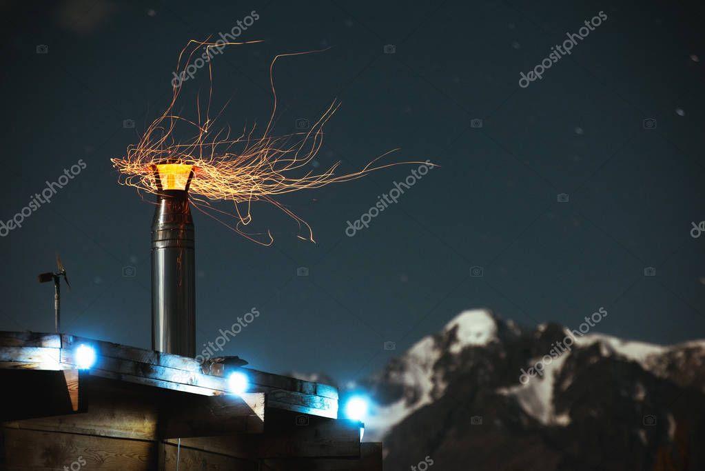 House chimney fire sparkles night