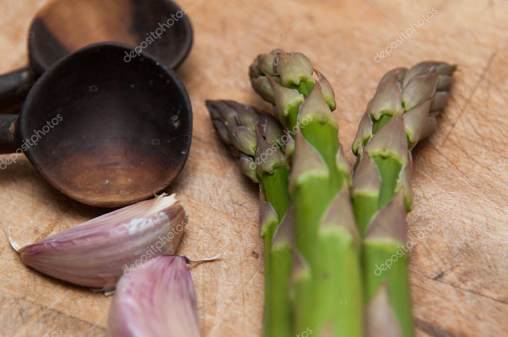 Fresh Asparagus on a rustic style background