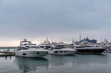 View of the sea port and private boats and yachts at the pier in Sochi,Russia.