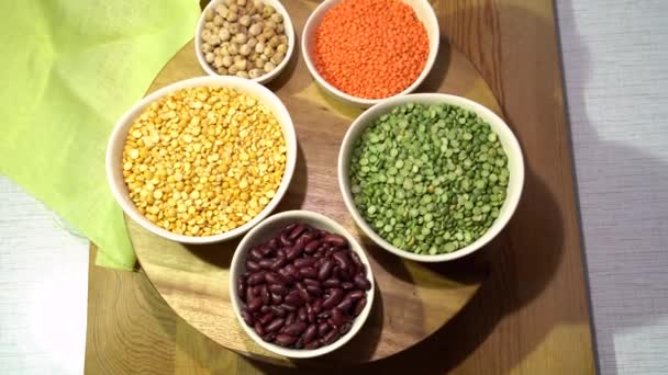 Motion rotating of the plate with set of lentils and legumes in Bowls.