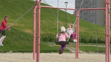 May Day in Opole Little Girls on Swings Playground Dad Adult Man is Swinging Together With the Kids Playground Families Spends Their Weekends Together