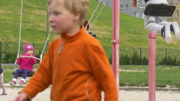 May Day Opole Mom Pulls and Pushes Kid on Swing Playground Little Kids Are Swinging Parents With Kids Playground Families Spends Their Weekends Together
