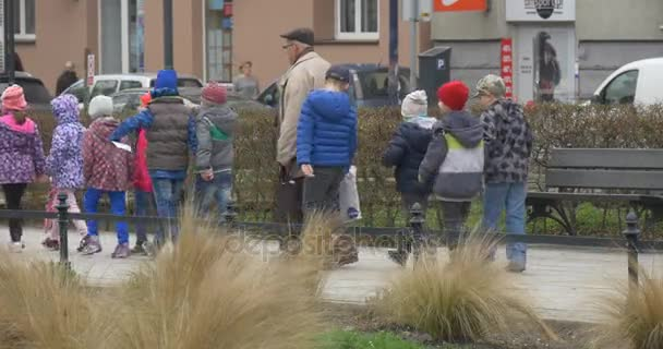 Easter Monday in Opole Poland Kids Are Walking Educators Teachers Lead the Children to the Excursion People on a City Street Cloudy Day in Springtime