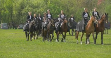 Polish Flag Day in Opole Female Riders Women Riding Horses Girls in Long Black Shining Gowns Cavalry at Parade Holiday in Sunny Day on Green Field