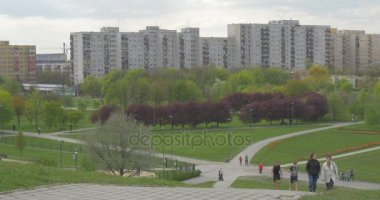 City Day Opole People Walk by Residential Area Cityscape Families at Springtime Landscape Footpaths Through Green Hills Red and Green Colorful Trees