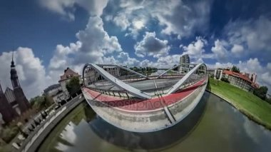 Little Tiny Planet 360 Degree Bridge Over Odra River in Opole With Red Bicycle Lane Cityscape in Sunny Day Time is Flying World is Changing Earth's Rotation