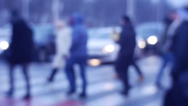 Camera Follows People Crossing Road Cars Stopped Pedestrians on Wintry Street Headlights Are Swiched on Busy Road Controlled Intersection Transportation