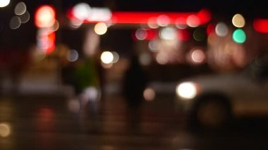 Misfocused Image of Pedestrian Crosswalk People Silhouettes Walking in a Hurry by Evening Wintry Street Blurred Lights Busy Schedule Night Cityscape